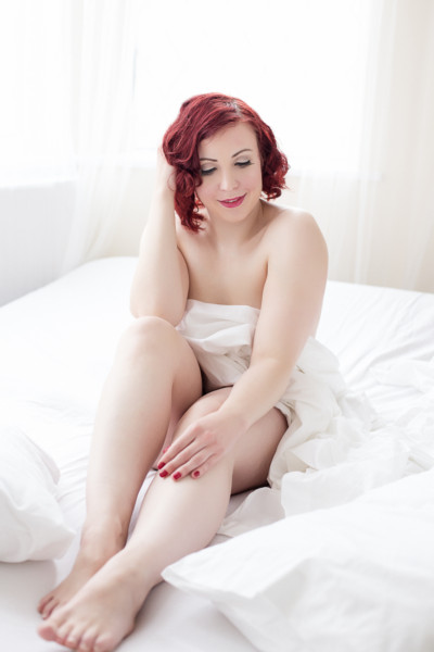 white sheets red lips boudoir