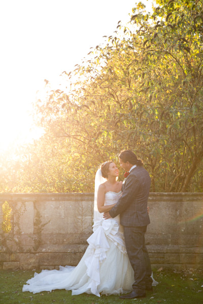 autumn wedding couple portrait with sunflare
